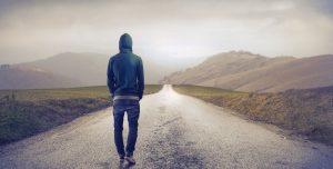 man walking down a road
