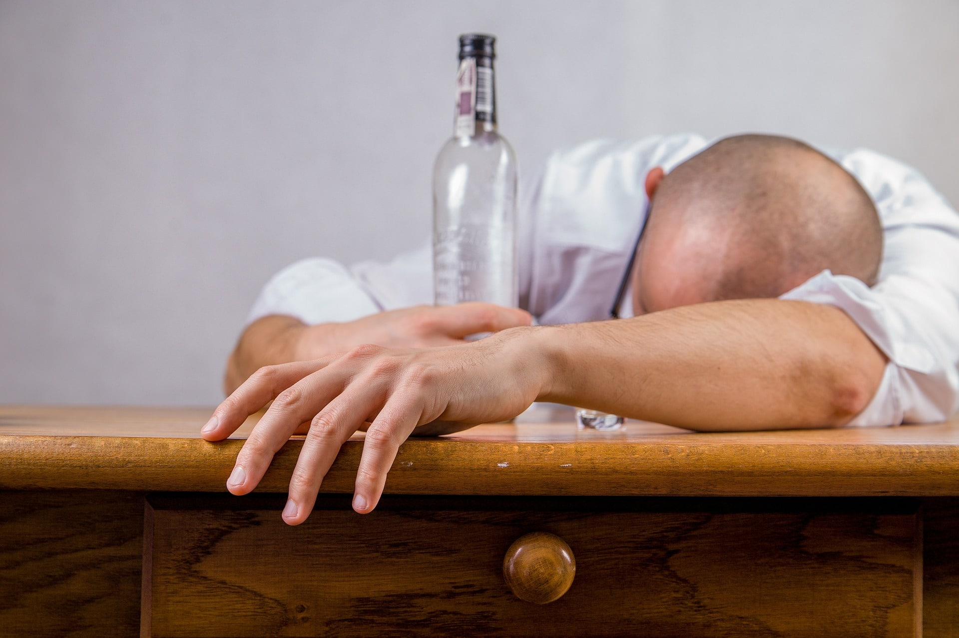 Depressed Man with Alcohol